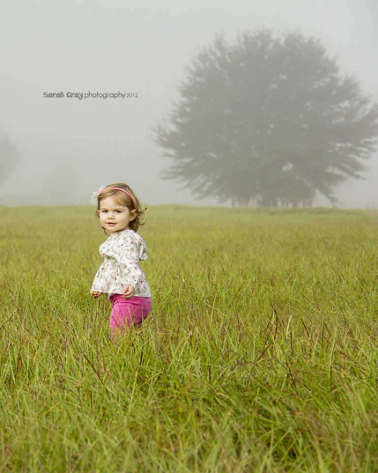Sassy little Esther in a field.