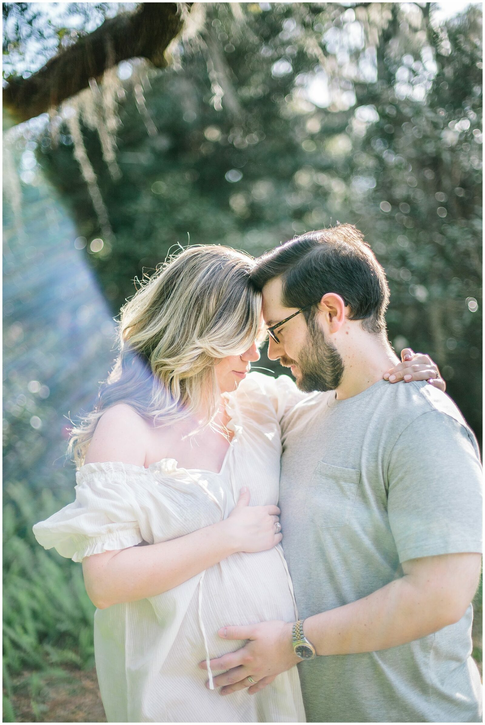 Maternity portrait of couple outdoors